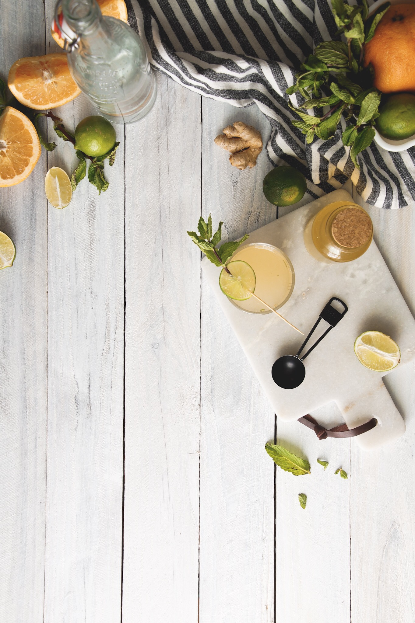 Refreshing with a bright citrus taste and a slight earthy-spiciness from fresh mint and ginger syrup make this  paloma cocktail perfect for winter sipping.- Winter cocktails  by amessybunkitchen