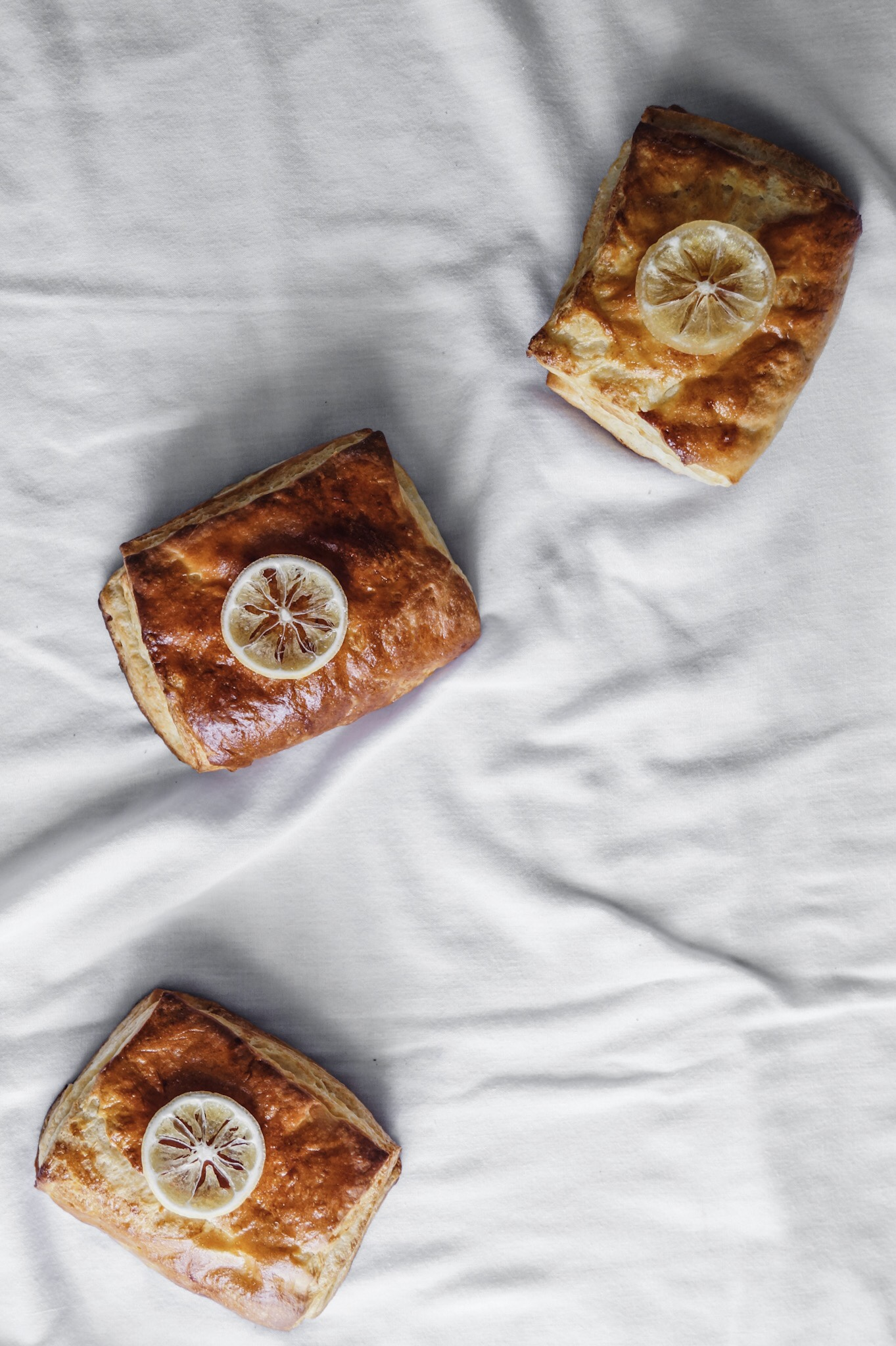 Super bright lemony filling tucked neatly inside the most delicious crispy-flaky Danish pastry. A early spring picnic and a wild story about boys. Lemon cream cheese danish pastry, homemade recipe. By Mandy Tetrault