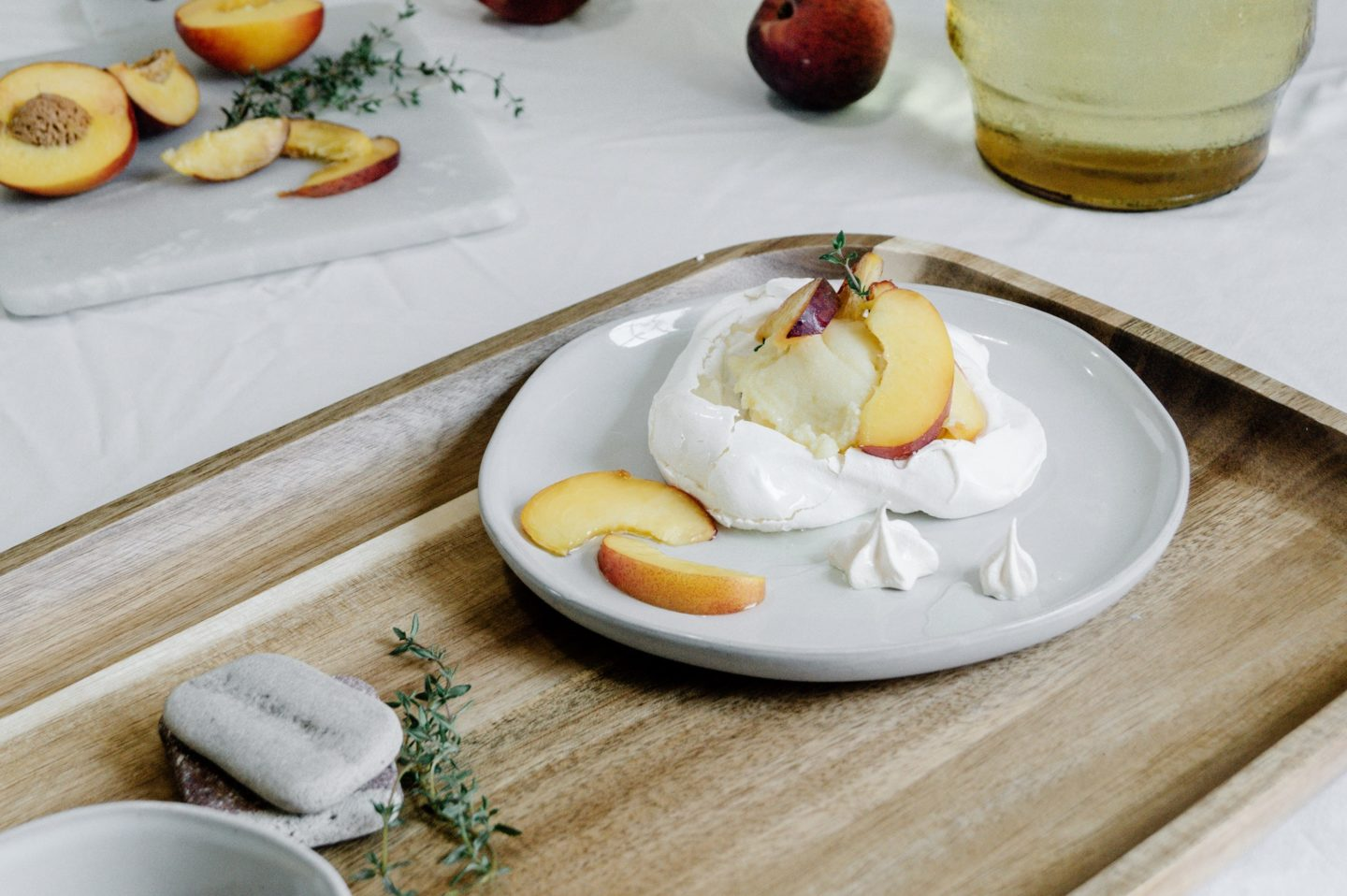 Individual semi-mini pavlova with peaches and cream make the best   (and prettiest) summer dessert!
