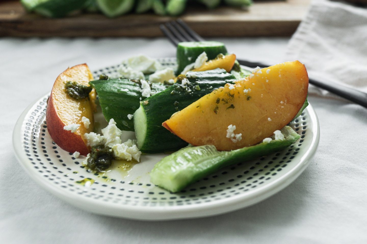 Cucumber peach salad with feta and zhoug dressing.