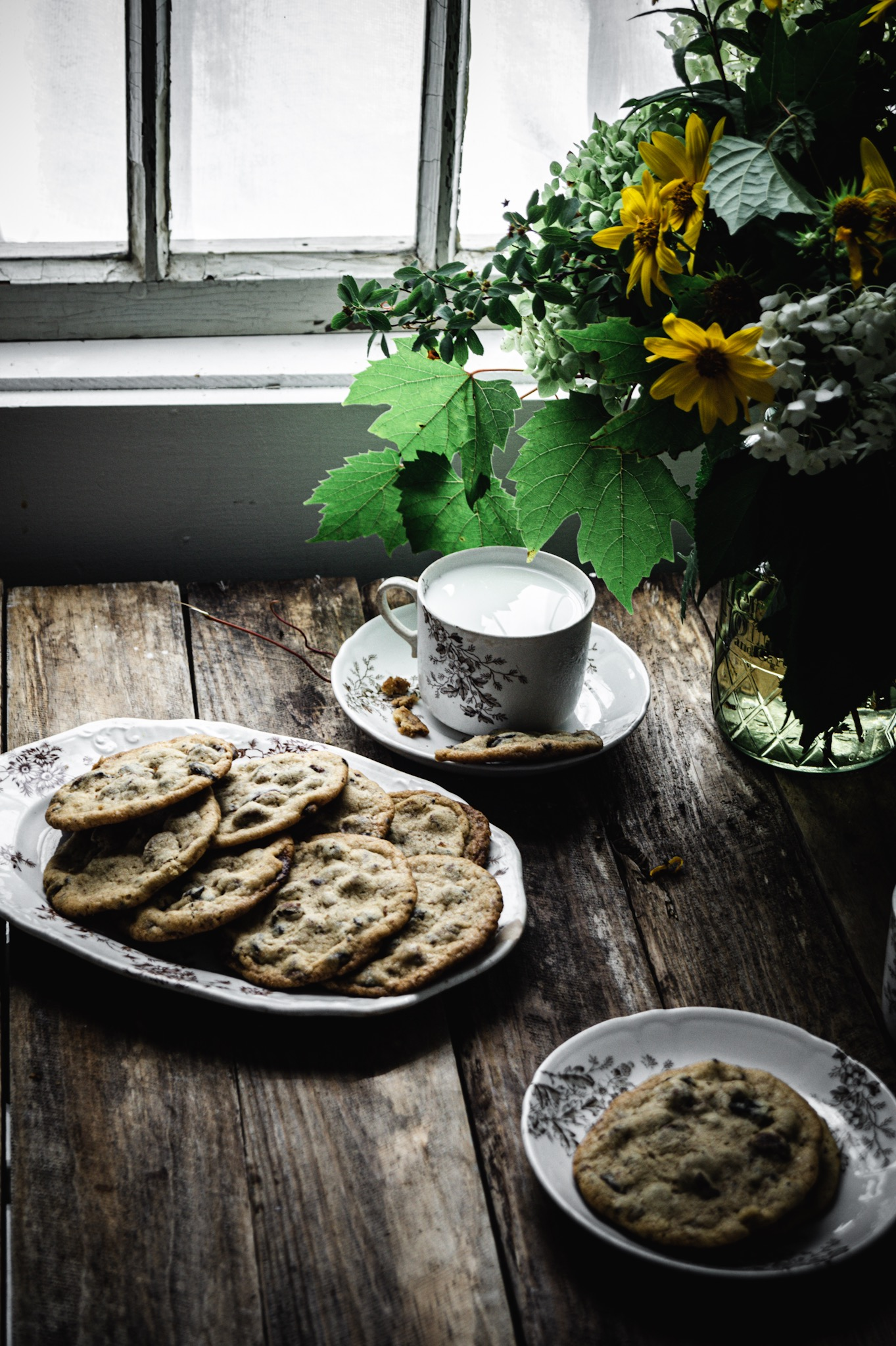 cold milk warm chocolate chip cookies and a bouquet of wild flowers