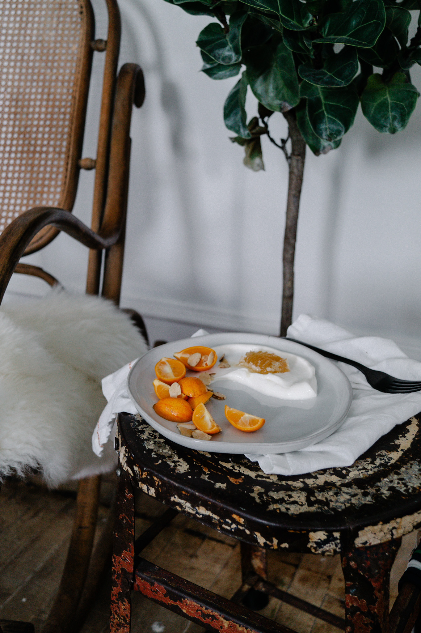 Citrus yogurt bowl with kumquats and almonds.