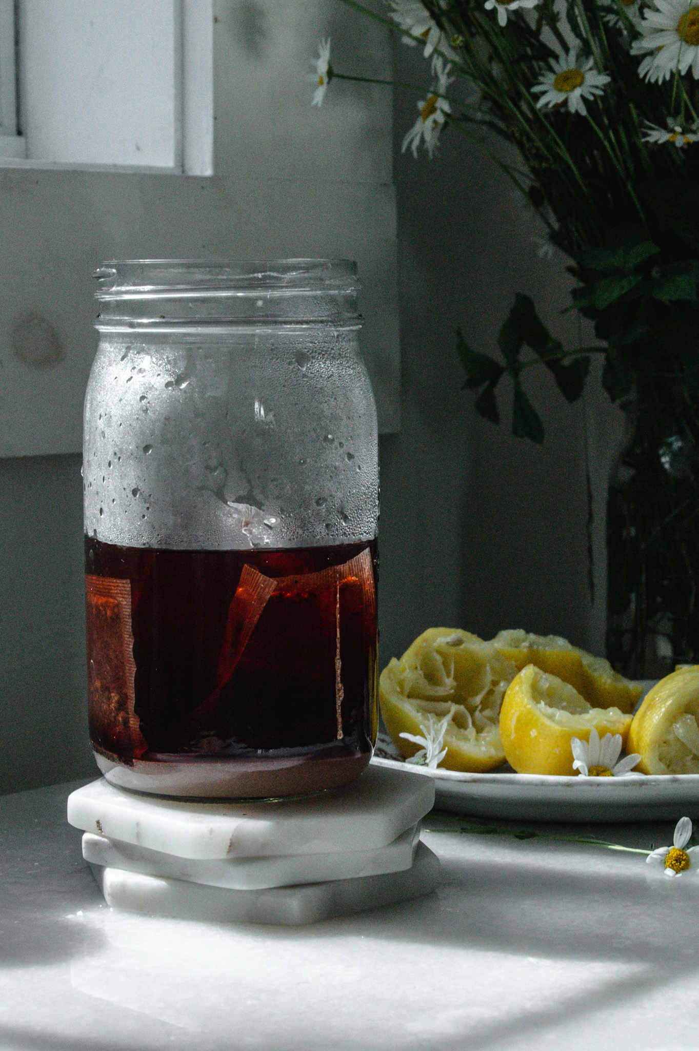 We start by making a highly concentrated tea using hot water raspberry herbal tea, sugar, and lemon juice