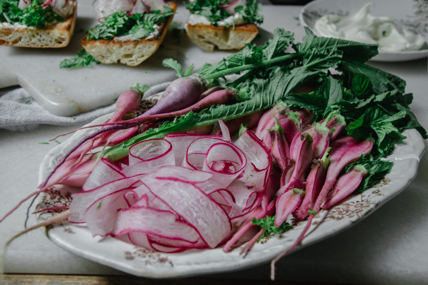 Slice radish with a vegetable peeler or mandolin to get this curly strips