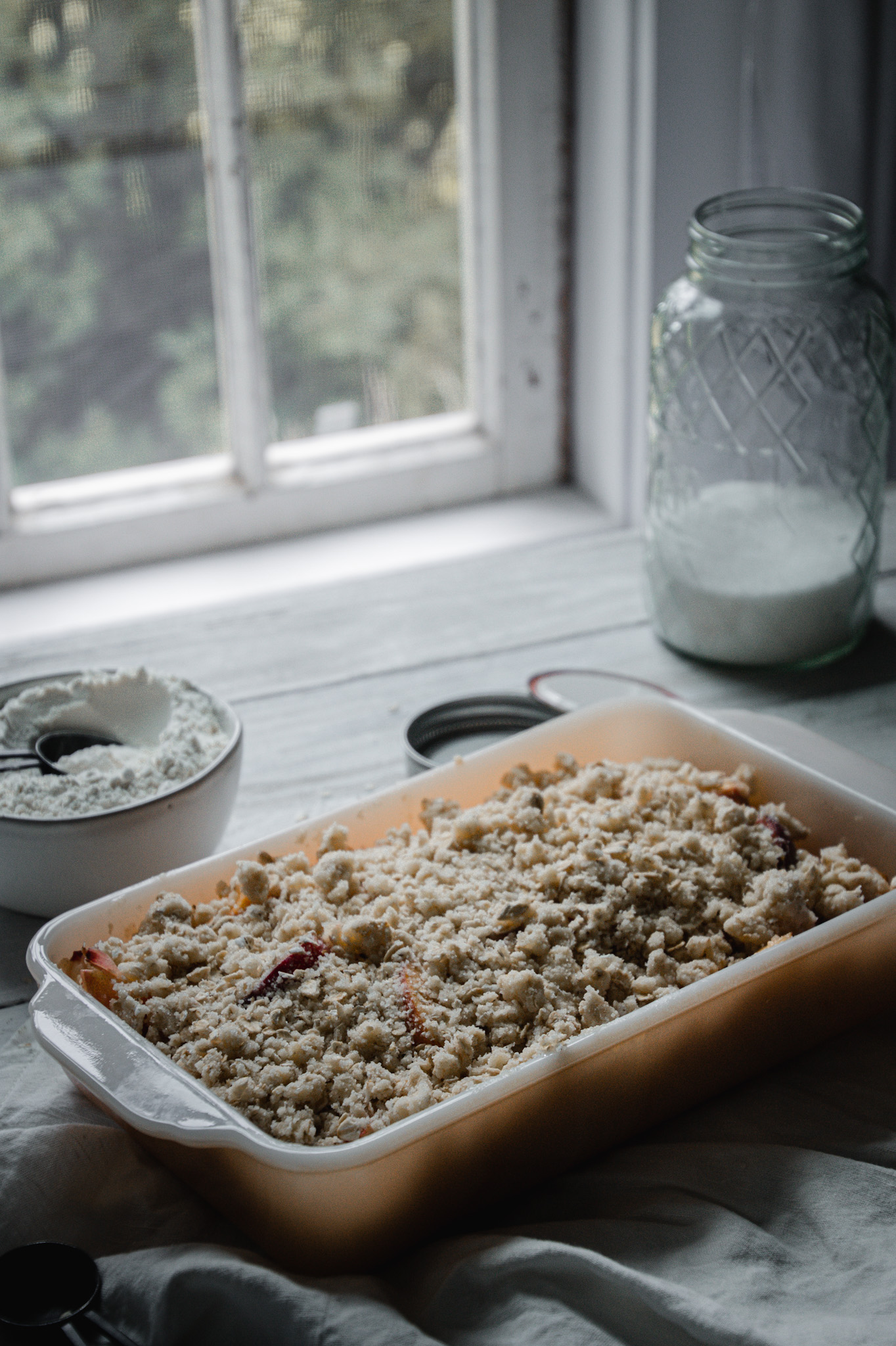 peach crisp ready to be baked or grilled - A Messy Bun Kitchen