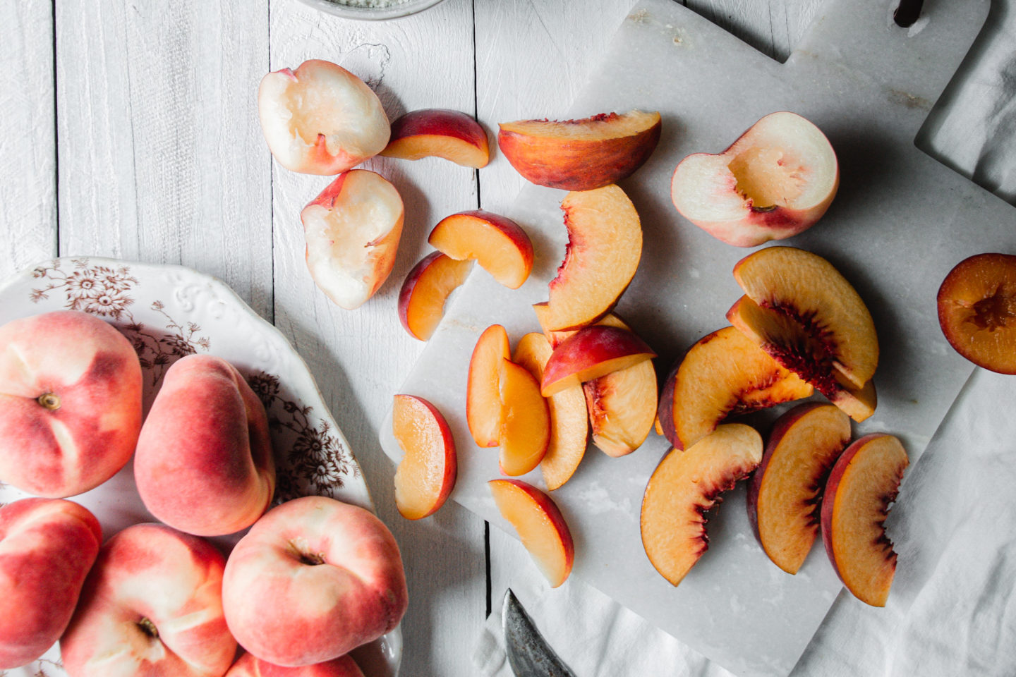 Fresh peach varieties sliced for making peach crisp.