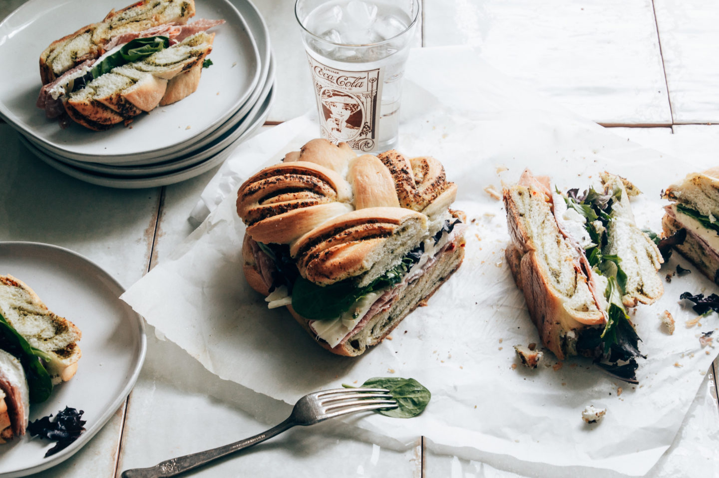 muffuletta sandwich is the perfect food for a laid back dinner with guests