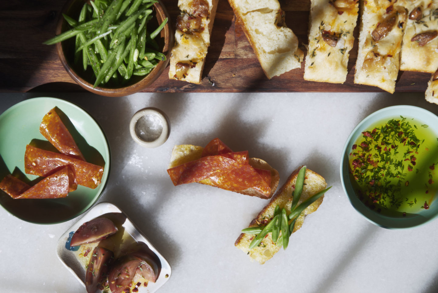 open-faced pepperoni and focaccia sandwiches served as a spring dinner board