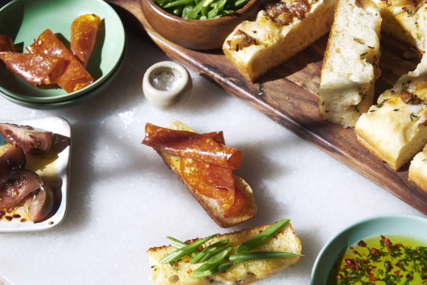 pepperoni open-faced focaccia sandwiches with tomato and green beans. Easy spring or summer meals