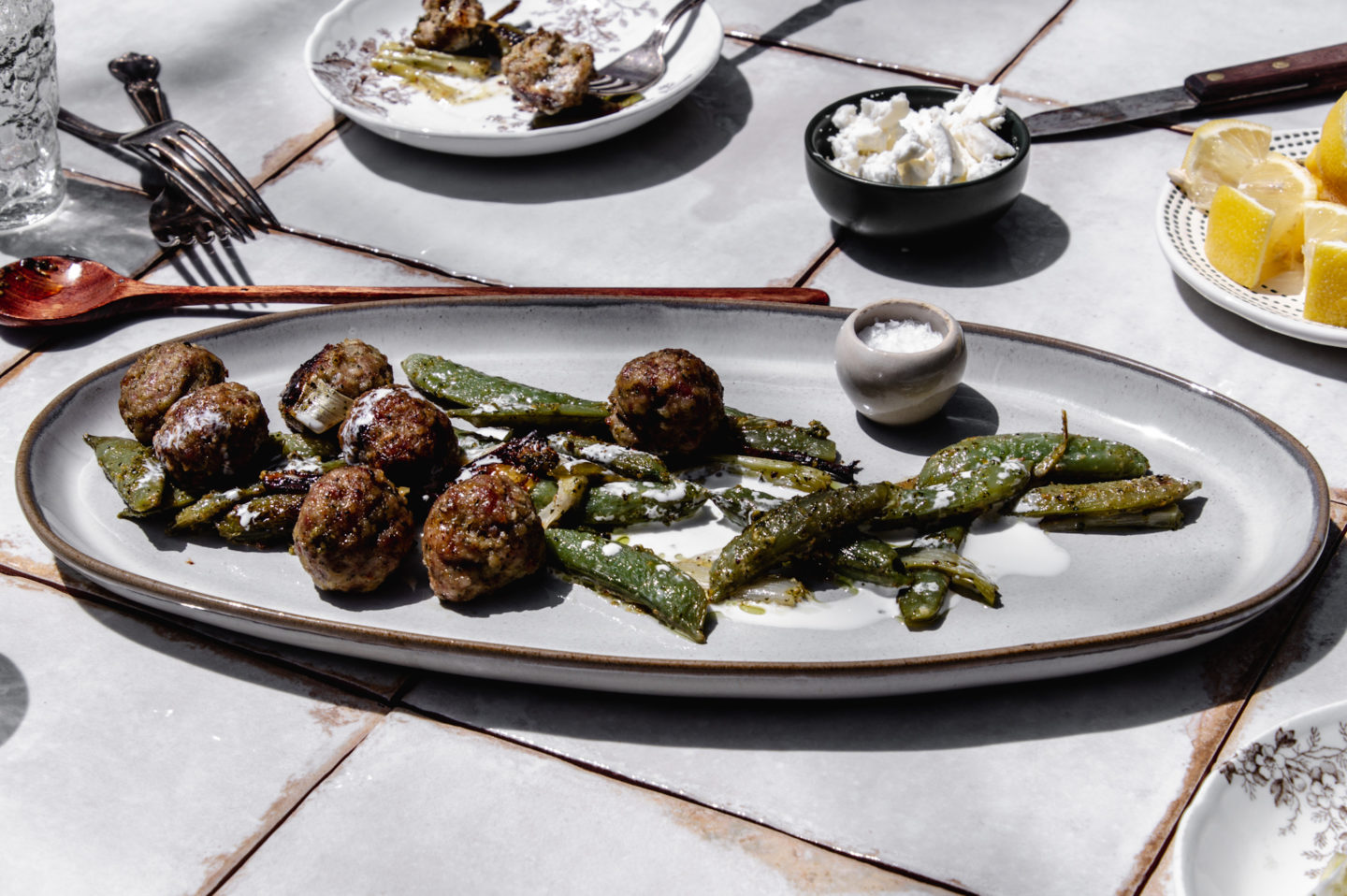 Delicious baked pesto pork meatballs. A simple sheet pan dinner that's perfect for weeknights.